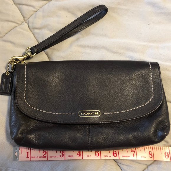 COACH brown leather clutch